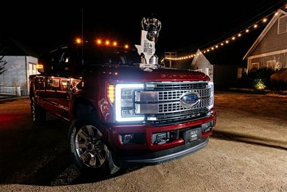 2017 Ford Super Duty with the Truck of Texas award and traveling trophy