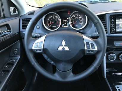 2017 Mitsubishi Lancer 2.4 SEL AWC steering wheel and instrument panel detail