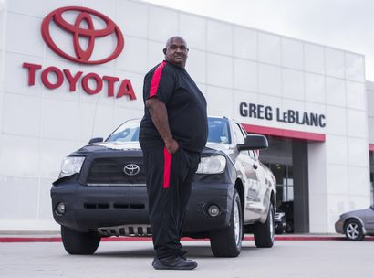 Victor Sheppard stands next to what was his million-mile Toyota Tundra at Greg LeBlanc Toyota
